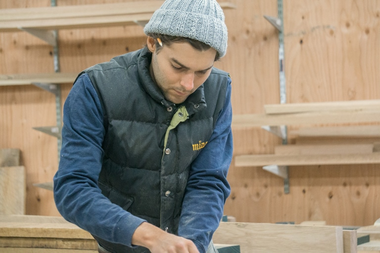 evan running an oak board through the planer