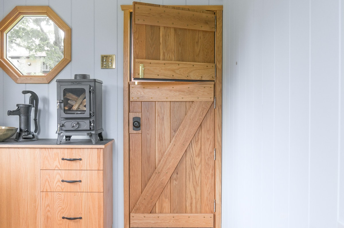 the interior side of a handcrafted solid cedar dutch door