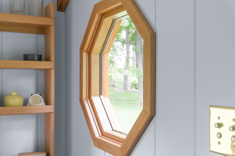 a handcrafted solid cedar octagon window in a gute shepherd hut