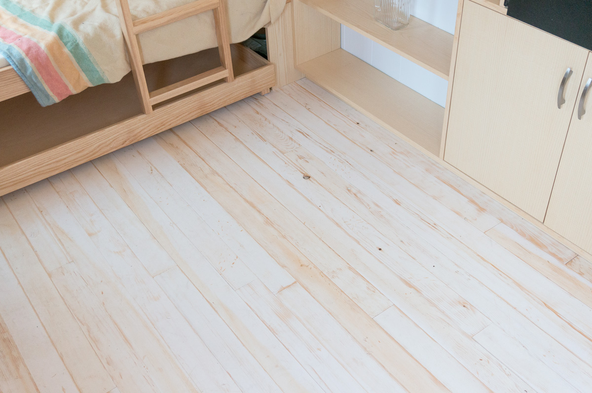 a distressed painted pine wood floor