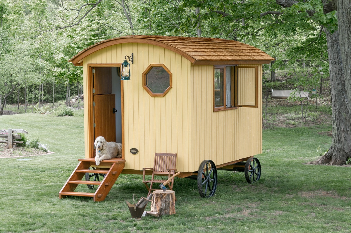a Sauble Gute shepherd hut in a backyard