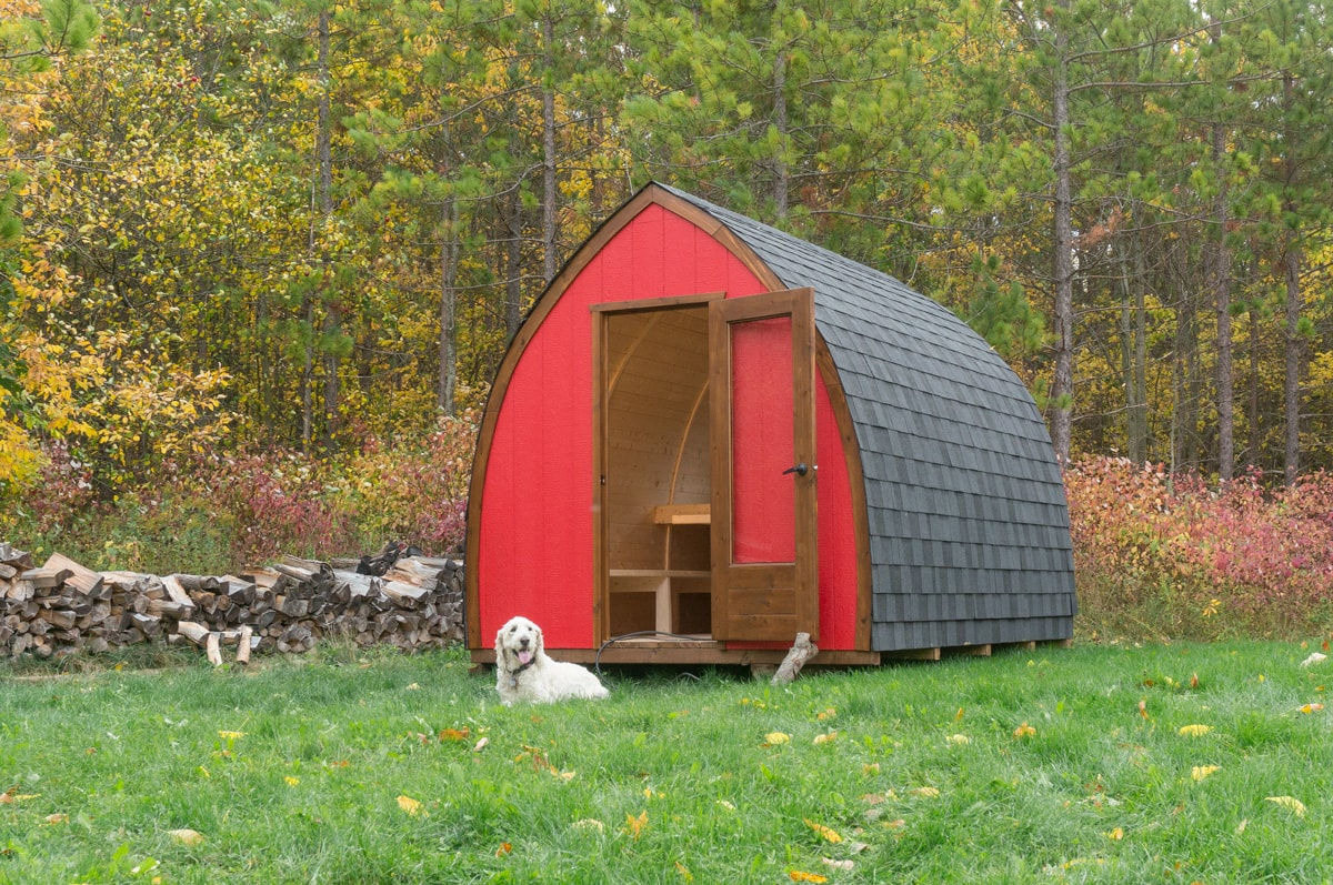 a red hunstville Gute cabin hut in an Ontario backyard