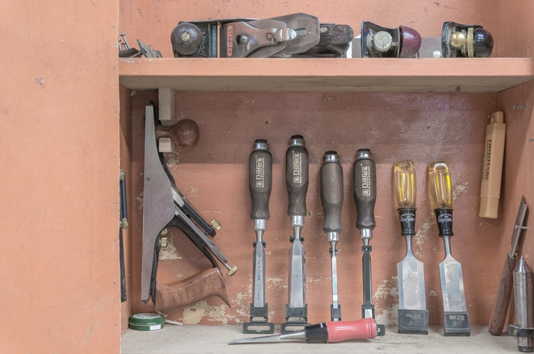 a collection of hand tools in the gute shop