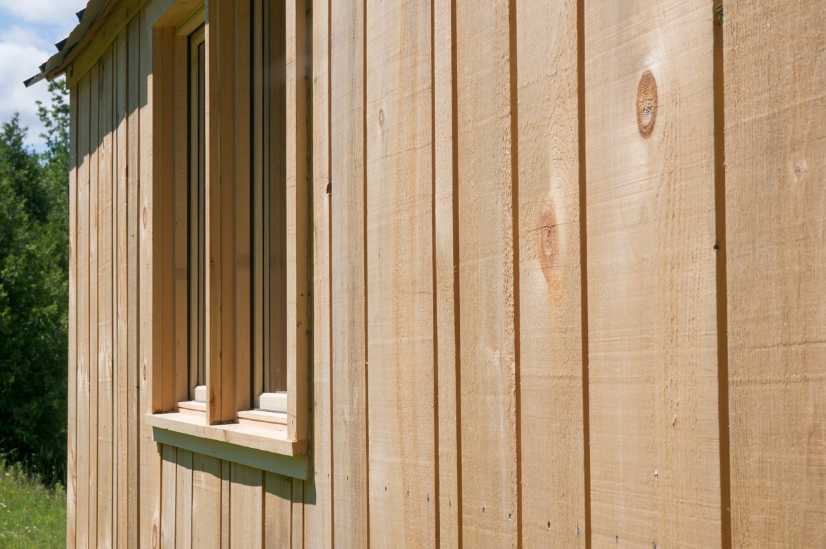 an unfinished pine siding on an sauble gute shepherd hut