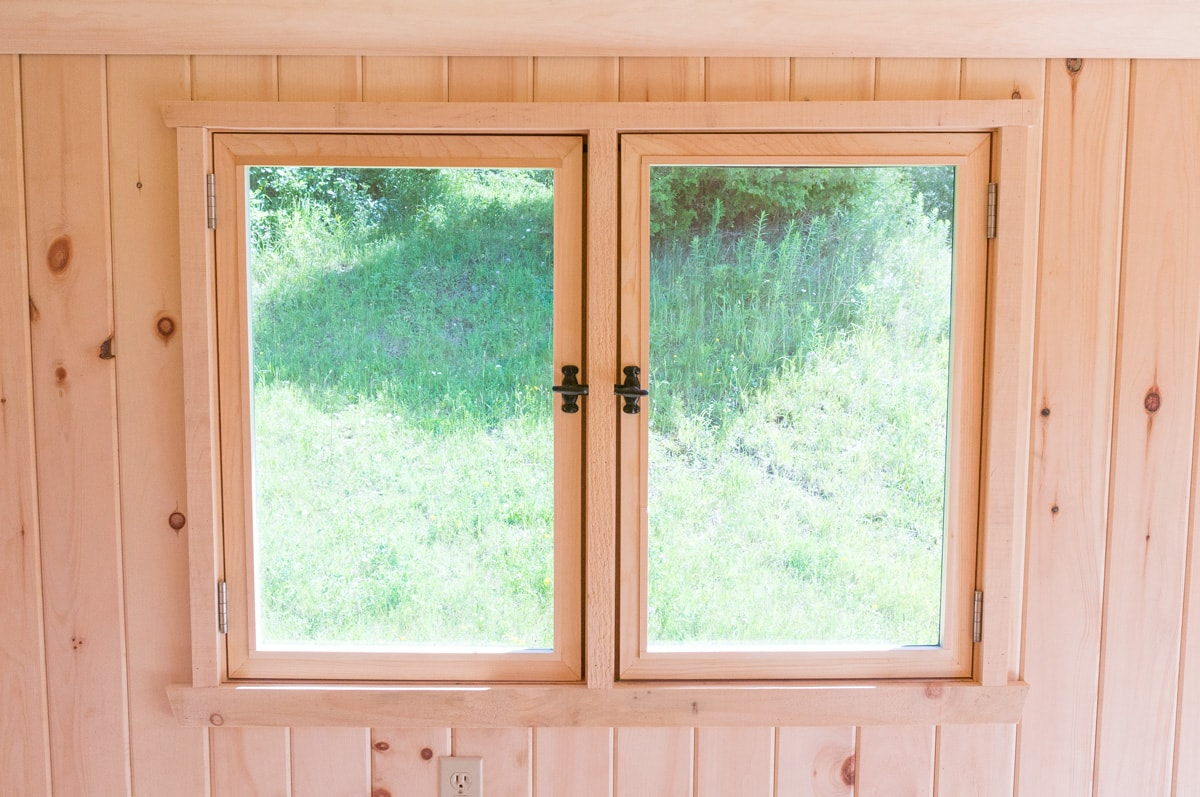 a handcrafted unfinished pine double window in a gute shepherd hut