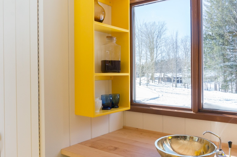 shelf unit in painted yellow