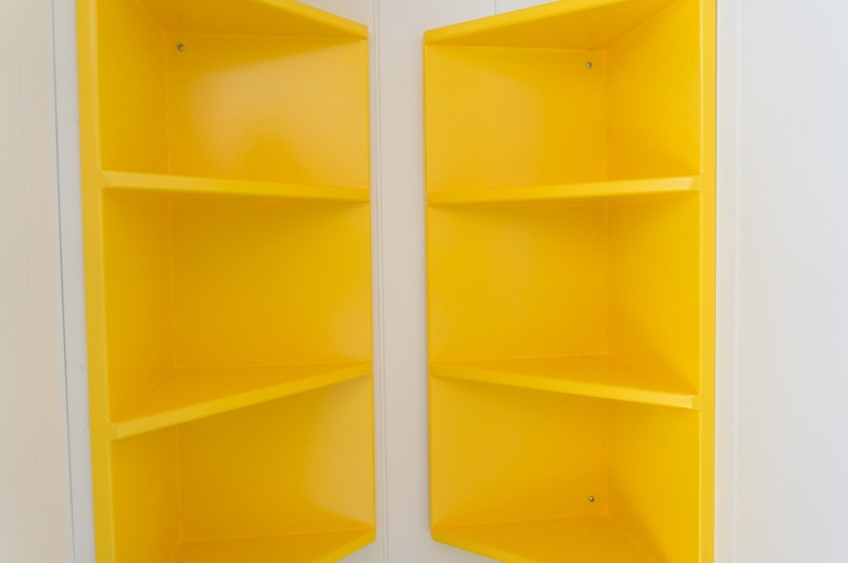 dual shelf unit in painted yellow