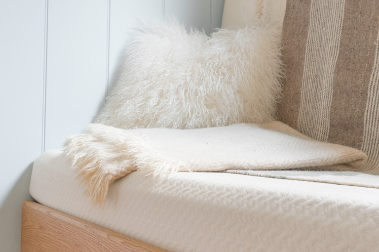 a wool blanket resting on a gute modular sofa
