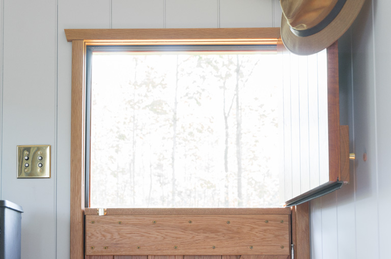 the top half of a gute dutch style door open to let fresh air in